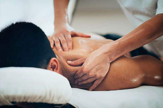 Professional massage therapist performing deep tissue massage